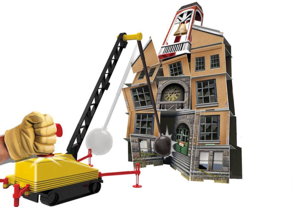 Zabawkowa kula do burzenia kartonowej szkoły