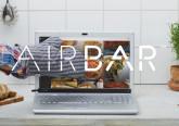 Urządzenie AirBar zamontowane na laptopie